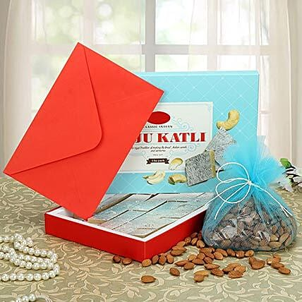 Sweets, dry fruits and a greeting card