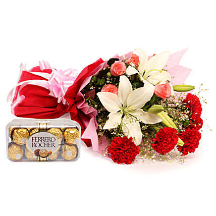 Sweetest Of All - Bunch of 2  Asiatic Lilies, 5 Red Carnations and 5 Pink Roses in a two layer paper packing and 200 grams Ferrero Rocher chocolates.