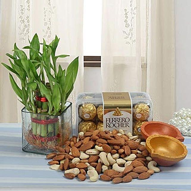 Combo of dry fruits, chocolates, diyas and lucky bamboo:Plants N Diyas