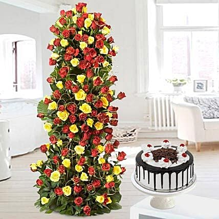 Unlimited Love - Arrangement of 100 Red N Yellow roses of 3-4 ft height with 1kg Black forest cake.