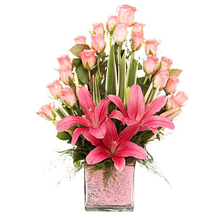 Glass vase arrangement of 20 pink roses, 3 pink asiatic lilies, draceane leaves, and vase filler gifts:Send Gifts to Bally