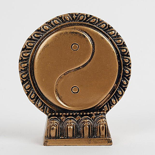golden yin yang statue