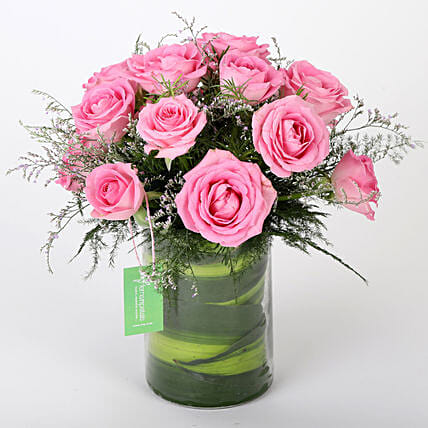 Glass vase arrangement of 15 pink roses, seasonal filler and draceane leaves womens day women day woman day women's day