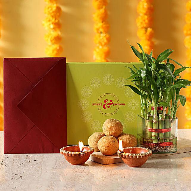 Lucky bamboo with greeting card, sweets and diyas:Send Plants N Diyas