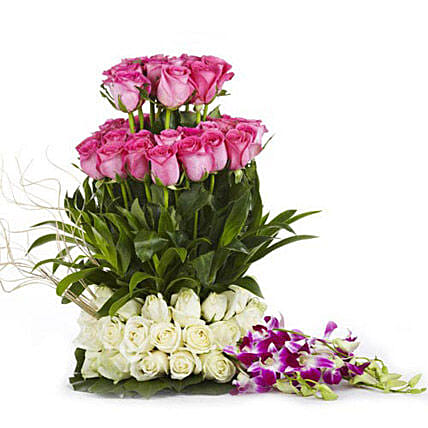 The Sweet Surprise - FNP exclusive 3 layer arrangement of 75 pink and colour roses and 3 blue orchids.