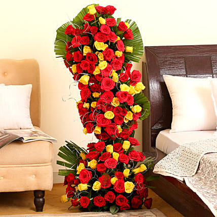 Endless Love - 3-4 ft high arrangement of 100 red and yellow roses.:Valentine Romantic Gifts