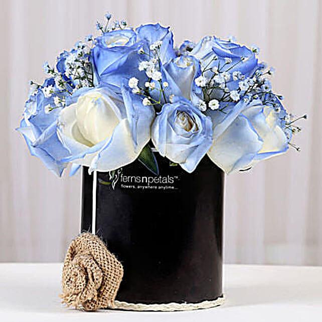 blue roses arrangement in black box