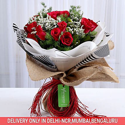 red roses in jute wrap bouquet