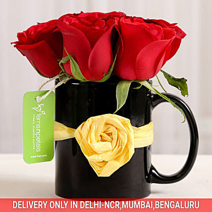 roses arrangement in attractive mug