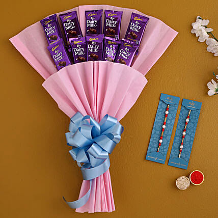 Buy Set Of 2 Pearl Rakhis and Dairy Milk Bouquet