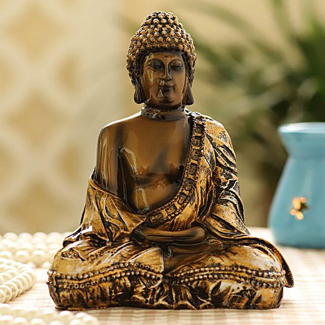 metallic idol of buddha