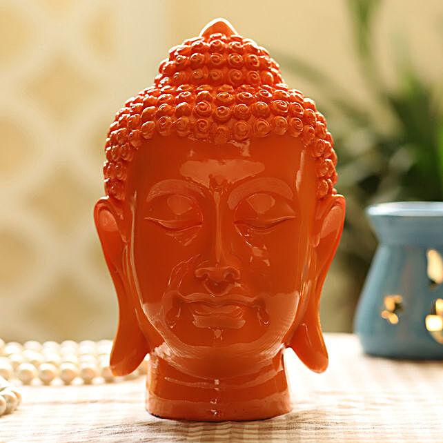 orange colour buddha idol