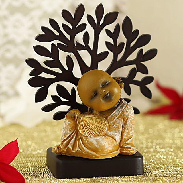 Monk Idol With Fan Under A Tree