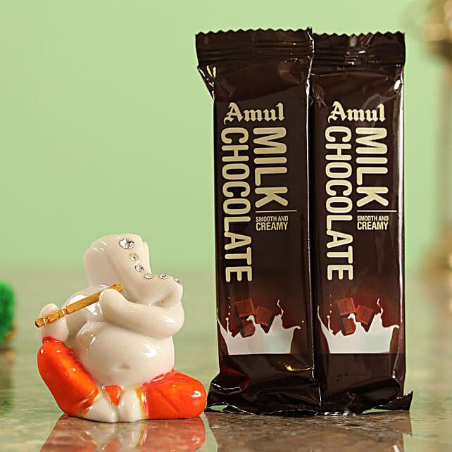 Amul Flowwrap Chocolates & Festive Ganesha Idol Combo  Online