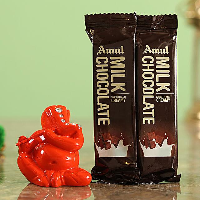 Amul Flowwrap Chocolates & Orange Ganesha Idol Combo  Online