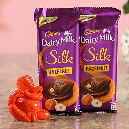 Dairy Milk Silk Hazelnut Chocolates & Orange Ganesha Idol Combo  Online