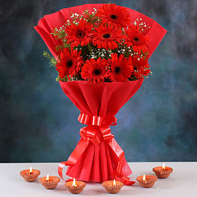 Ravishing Red Gerberas Bouquet & Clay Diyas:Diwali Flowers