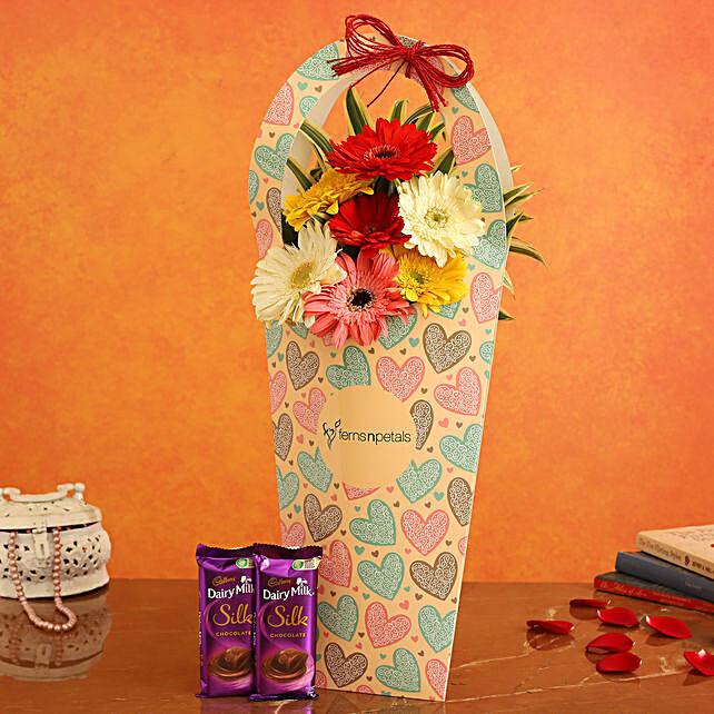 Mixed Flowers In FNP Heart Sleeve and Cadbury Silk