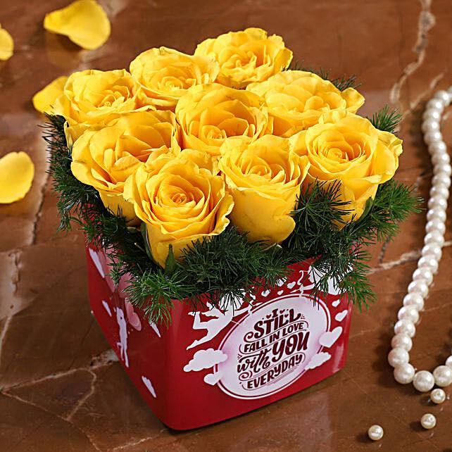 yellow roses in  vase arrangement for valentine