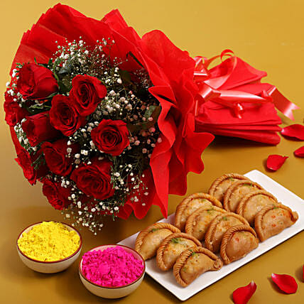 Multicoloured gulal packets, red rose bouquet, gujia hamper