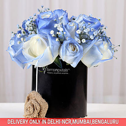 blue roses arrangement in black box:Gifts for Basant Panchami