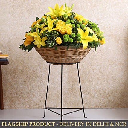 Vibrant Mixed Flowers In Cane Basket With Iron Stand
