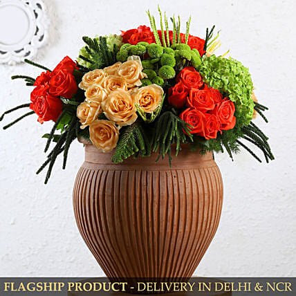 Alluring Mixed Flowers In Terracotta Pot