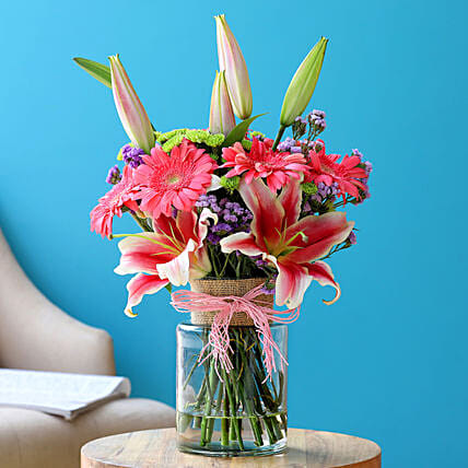 Lovely Mixed Flowers In Jute Wrapped Jar