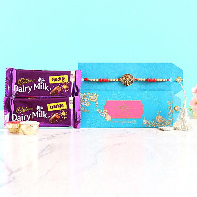 Divine Ganesha Rakhi And Chocolates