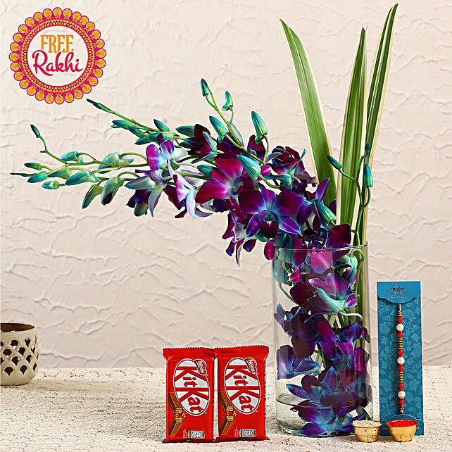 Free Pearl Rakhi With Orchids Vase and Nestle Kitkats:Rakhi with Flowers