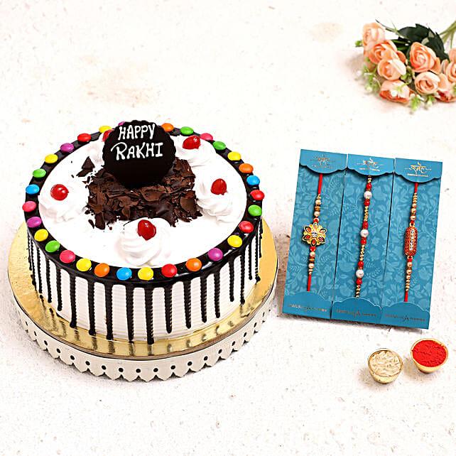 3 Pretty Rakhis N Black Forest Gems Cake:Order Rakhi with Cakes