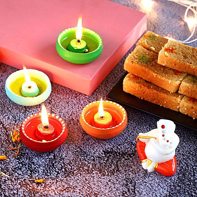 4 Colourful Diyas & Ganesha Idol With Milkcake