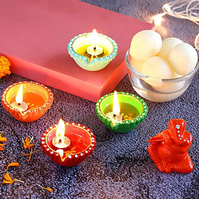 4 Colourful Diyas & Ganesha Idol With Rasgulla