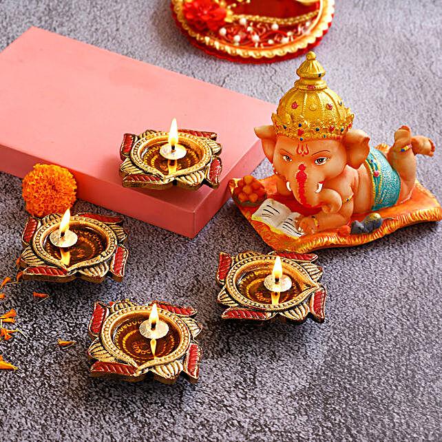 4 Swastik Diyas & Cute Bal Ganesha Idol