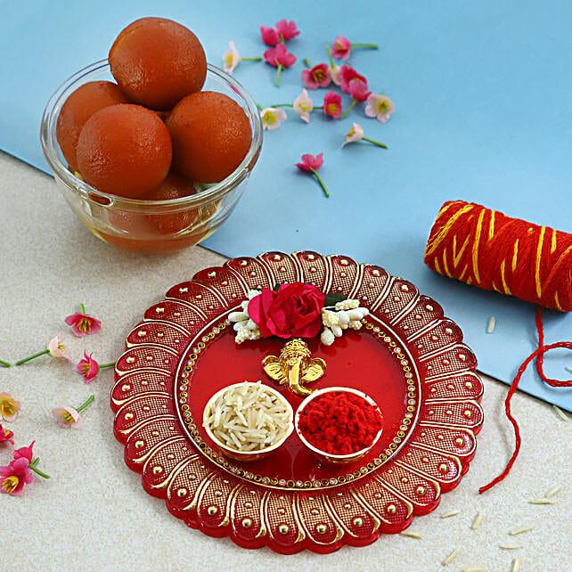 Blissful Bhai Dooj Ganesha Floral Thali and Gulab Jamun