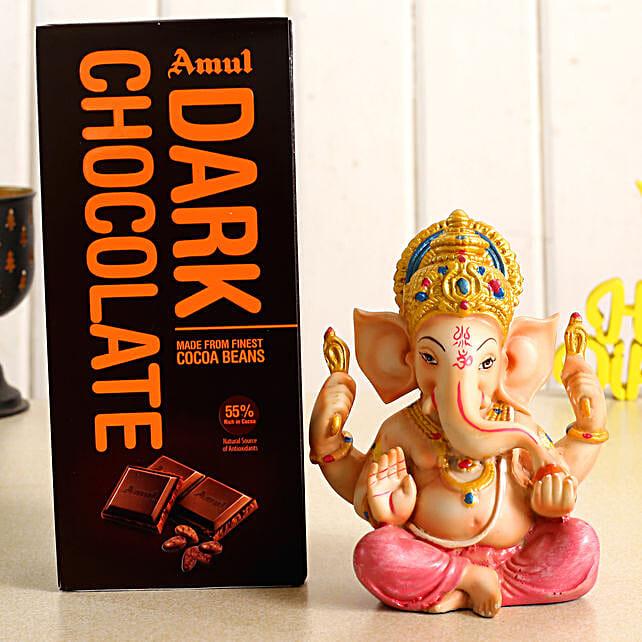 Ganesha Charm Idol and Amul Dark Chocolate