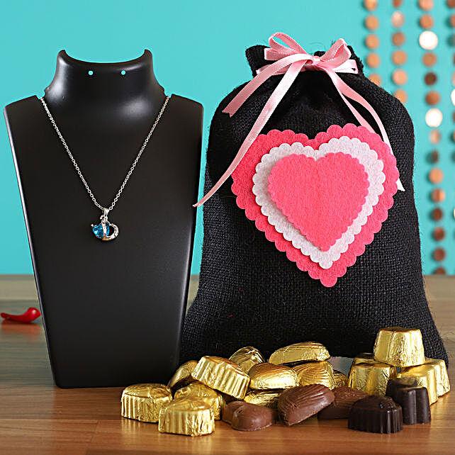 Valentine Chocolates In Black Potli & Heart Pendant Online
