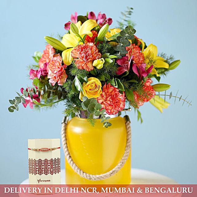 Mixed Flower Arrangement and Rakhi:Rakhi with Flowers