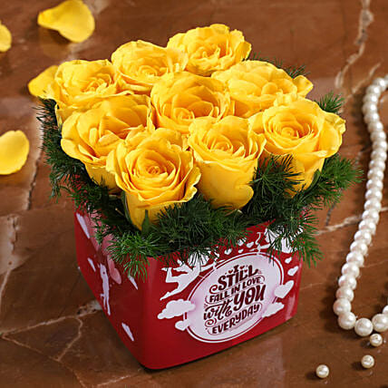 yellow roses in  vase arrangement for valentine