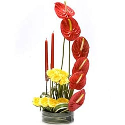 You Are Beautiful - Arrangement of 6 Red Anthuriums & 10 yellow roses with 2 candles in a round glass vase.