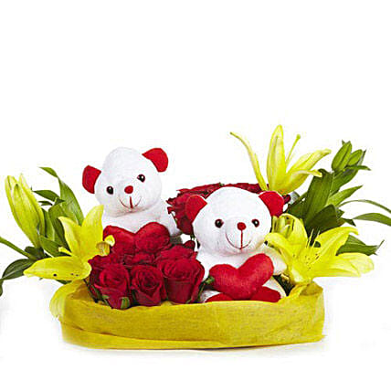 You N Me - Basket arrangement of 12 Red roses with 2 cute soft toys, 2 yellow Asiatic lilies wrapped in paper packing.:Soft Toys for Christmas