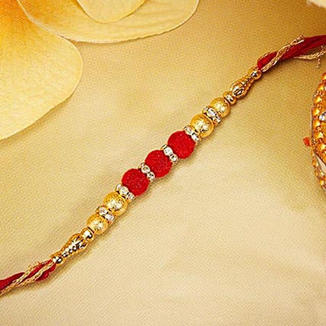 Gold And Red Velvet Beads Rakhi In Lebanon Gift Gold And Red Velvet Beads Rakhi Ferns N Petals