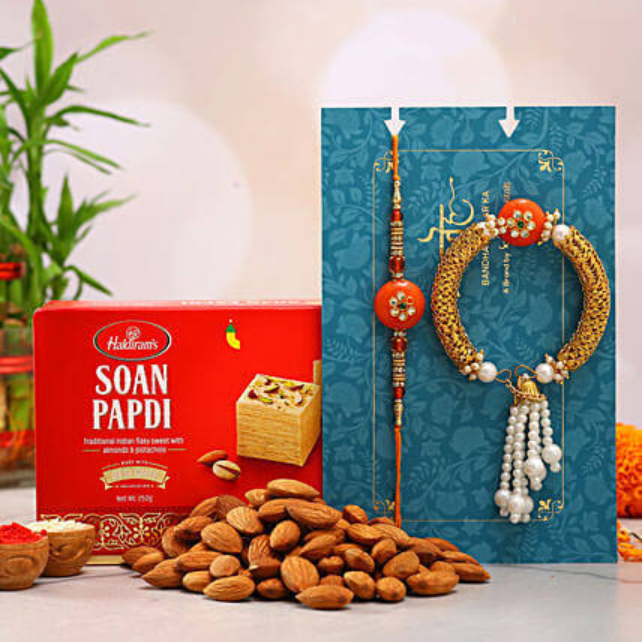 Orange Pearl Lumba Rakhi Set And Almonds With Soan Papdi