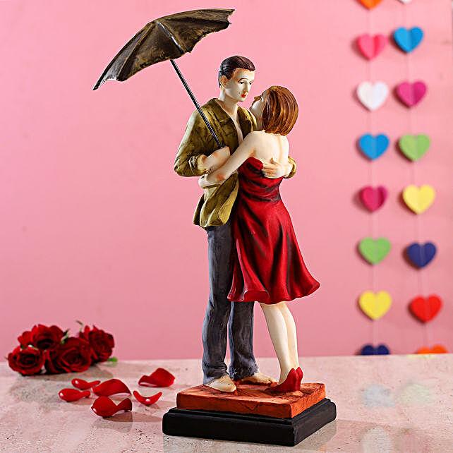 Hugging Couple Under Umbrella Figurine