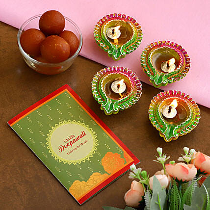 Decorative Floral Diyas With Greeting Card And Gulab Jamun:Send Diwali Gifts to New Zealand