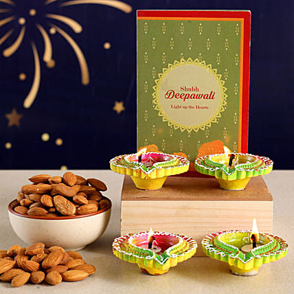 Floral Diyas With Greeting Card And Almonds