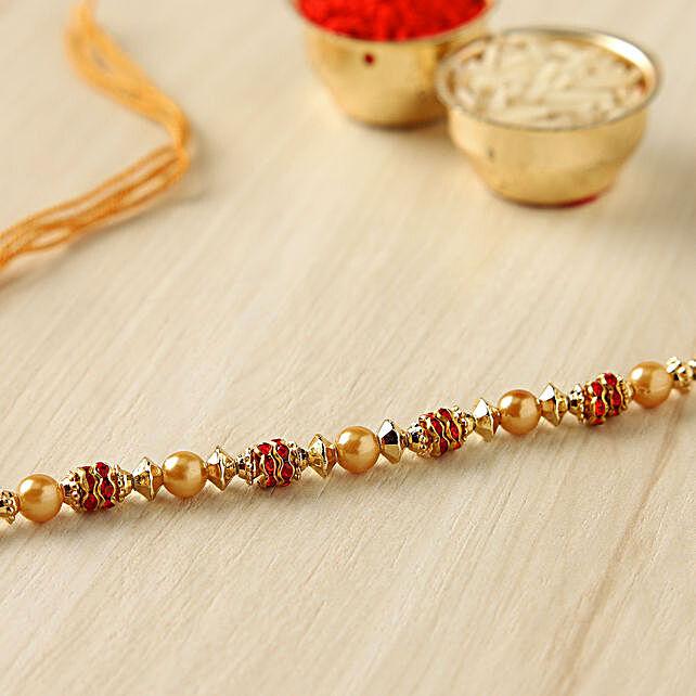 Golden Red Pearl Thread Rakhi