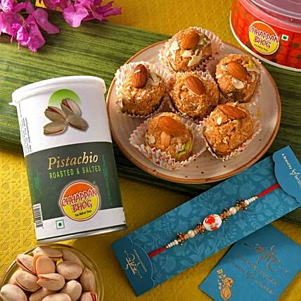 White Beads Pearl Rakhi With Badam Pinni And Roasted Pistachio:Rakhi Delivery in Oman