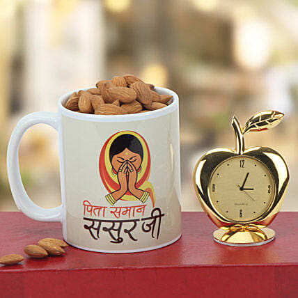 Hamper of coffee mug, almonds and golden apple shaped table clock