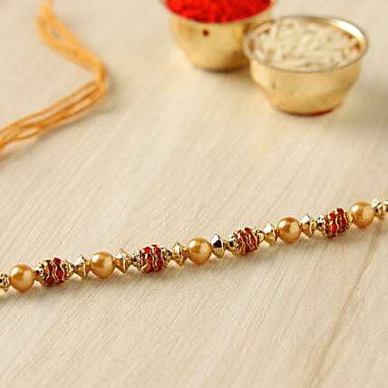 Golden Red Pearl Thread Rakhi